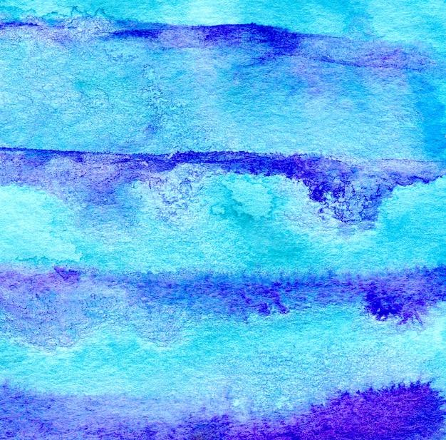 青い水彩画手描きの縞模様の背景。明るい色。