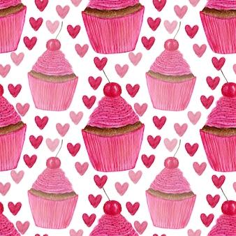 手でシームレスなパターンには、心と甘いチェリーの水彩カップケーキが描かれています。