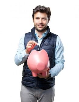 豚のベストインサートコインを持つ男
