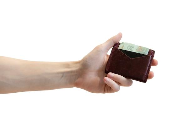 男性の手で白で隔離されるスリムなクレジットカード財布