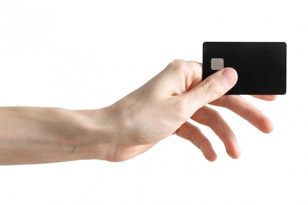 男性の腕を白で隔離される空白の黒い銀行カード。クレジットカード。