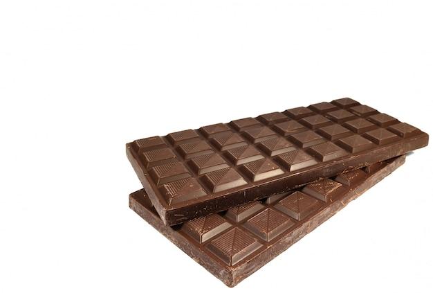 テキストとデザインのための空き領域を白い背景で隔離のチョコレートバー
