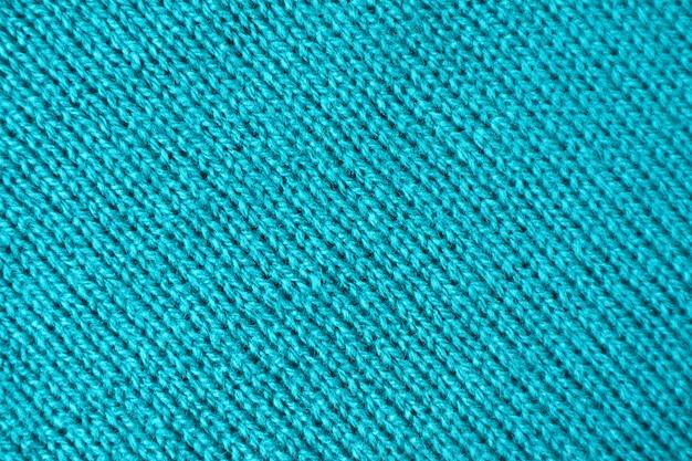 ターコイズブルー色のアルパカニットウール生地のテクスチャ