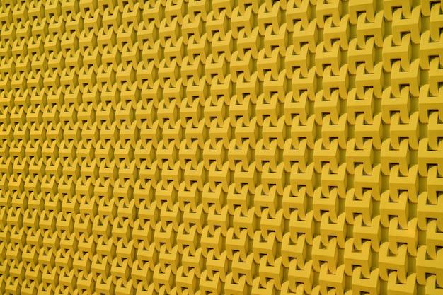 マスタードの黄色の背景のモダンな建物の外壁のパターン