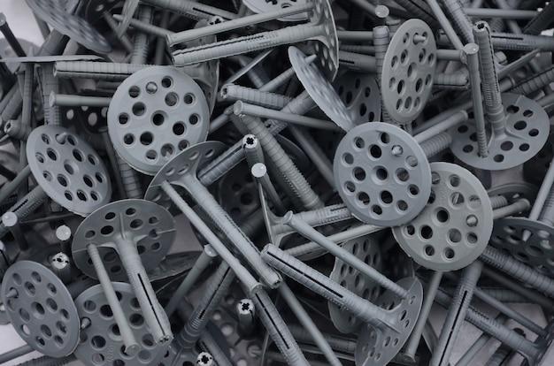 多くの灰色のプラスチック製ダボの背景パターン
