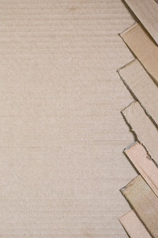 ベージュ色の段ボール紙が多い背景画像