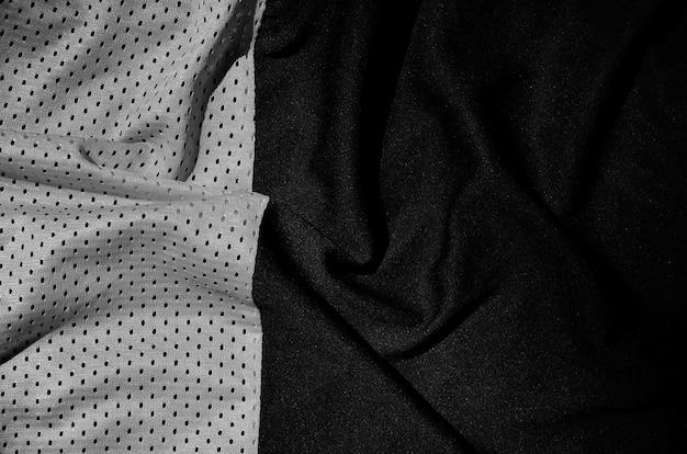 スポーツ服生地のテクスチャ背景。グレーポリエステルナイロン布繊維表面の平面図です。ダーク