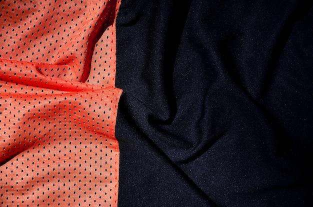 スポーツ服生地テクスチャ背景、赤い布繊維表面のトップビュー