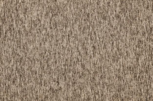 Настоящий вересковый трикотаж из синтетических волокон текстурированного фона. цветная текстура ткани. фон с тонким полосатым узором