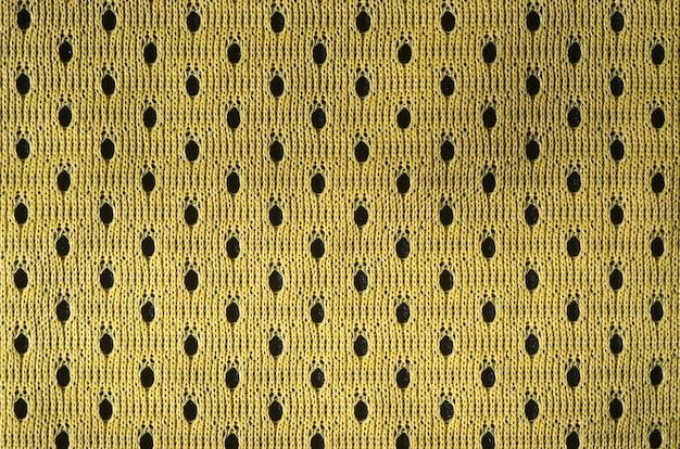 Крупным планом желтого полиэстера нейлона желтые шорты спортивной одежды, чтобы создать текстурированный фон