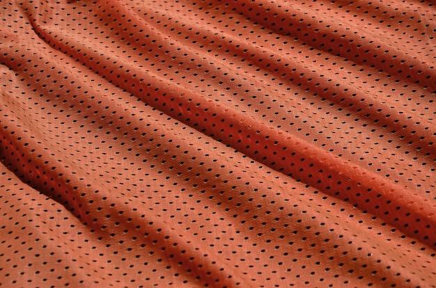 ポリエステル繊維製のスポーツウェアの質感。スポーツトレーニングのための上着は伸縮性のあるナイロン生地のメッシュの質感を持っています