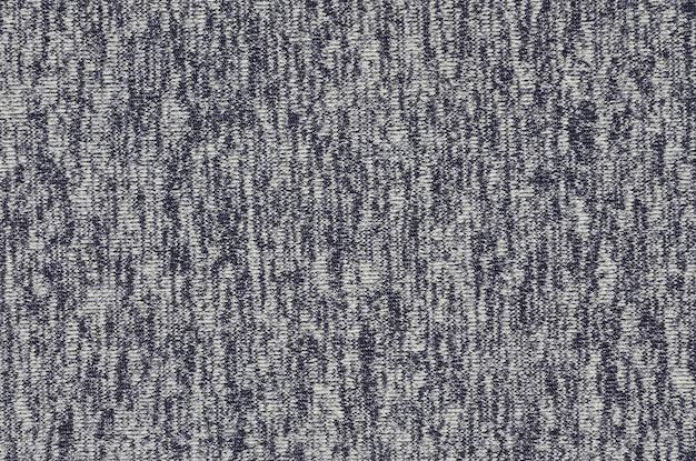 Настоящий вересковый трикотаж из синтетических волокон текстурированного фона.