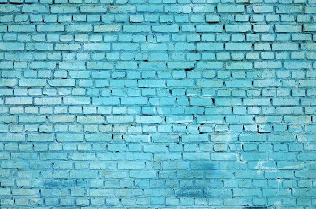正方形のレンガブロック壁の背景色と質感。ブルー塗装
