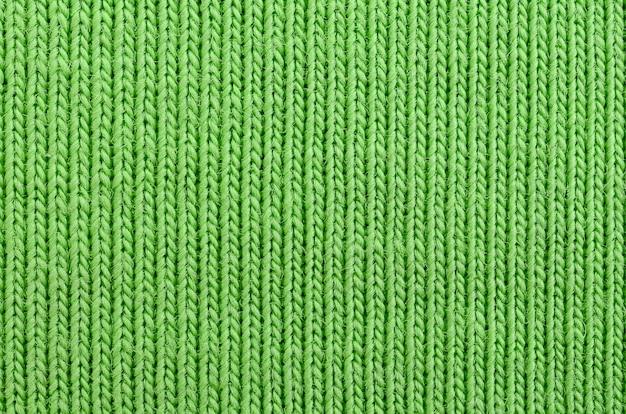 Текстура ткани ярко-зеленая. материал для изготовления рубашек и блузок