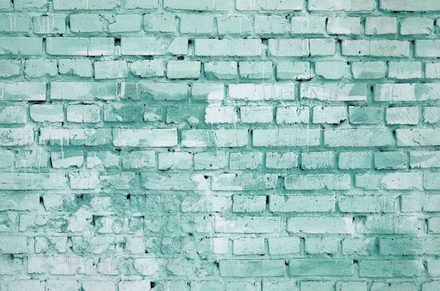 正方形のレンガブロック壁の背景色と質感。緑色で塗装