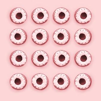 多くの小さなプラスチック製ドーナツは、パステルカラーのカラフルな背景の上にあります。