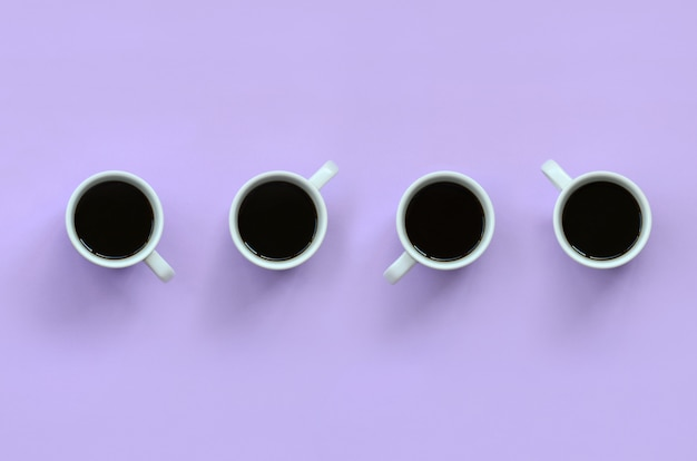 テクスチャ背景に多くの小さな白いコーヒーカップ