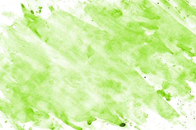 白い紙の上の薄緑色の水彩画の背景