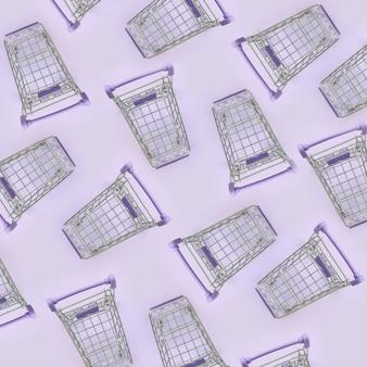 紫色の背景に多くの小さなショッピングカートのパターン。ミニマリズムフラットレイアウト平面図