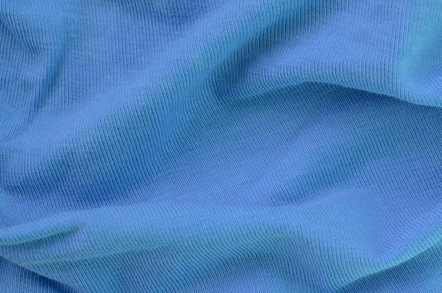 青い色の布の質感。シャツやブラウスを作るための材料