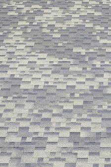 瀝青コーティングを施した平屋根瓦の背景モザイクのテクスチャ