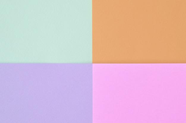 ファッションパステルカラーのテクスチャ。ピンク、バイオレット、オレンジ、ブルーの幾何学模様のペーパー。