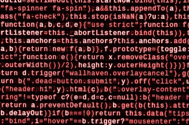 ラップトップでプログラミングコードを記述します。コンピューター画面上のデジタルバイナリデータ