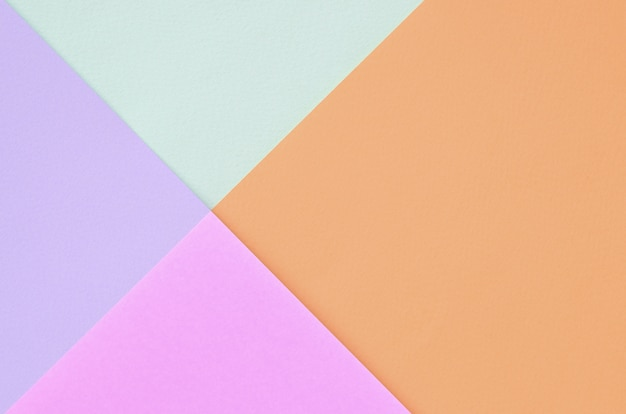 ファッションパステルカラーのテクスチャ背景。ピンク、バイオレット、オレンジ、ブルー