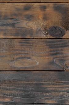 暗い茶色の木製の水平板の背景表面