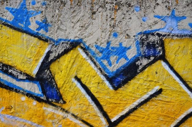 落書き図面の詳細のビューを閉じます。ストリートアートと破壊行為の背景テーマ。エアロゾル塗料で塗装された壁のテクスチャ