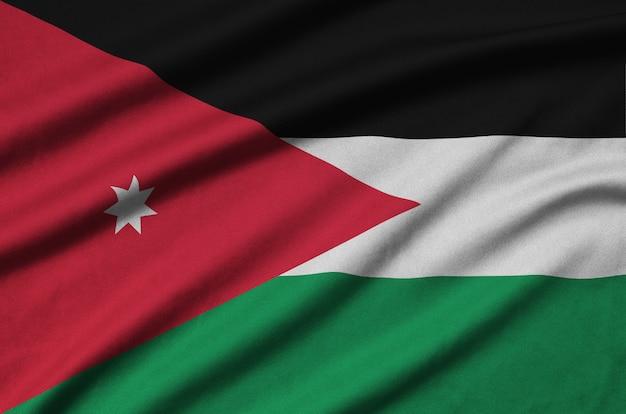 ヨルダンの旗は、多くのひだのあるスポーツ布の生地に描かれています。