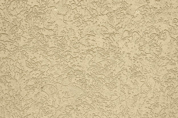 樹皮カブトムシスタイルでベージュの装飾的なプラスターのテクスチャ