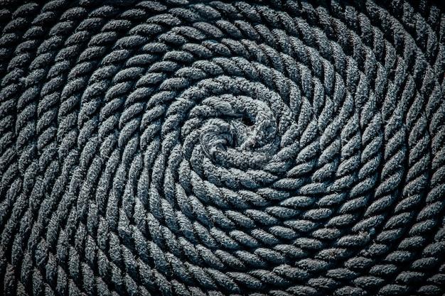 ボートのロープはらせん状に敷かれていました。バックグラウンド。