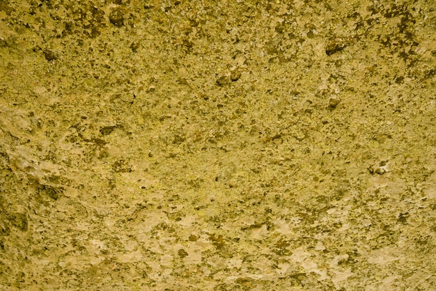 花崗岩のテクスチャ、背景の黄色、金色の花崗岩の表面