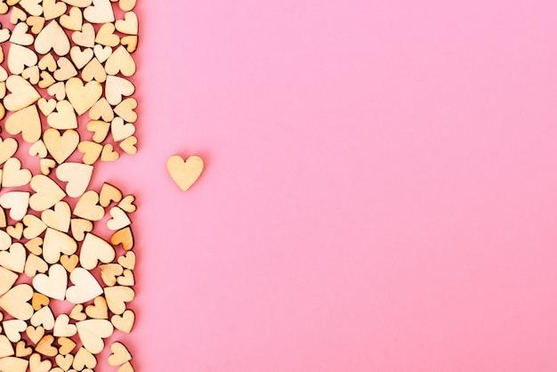 Святого валентина фон сердце осталось. цвет розовый.