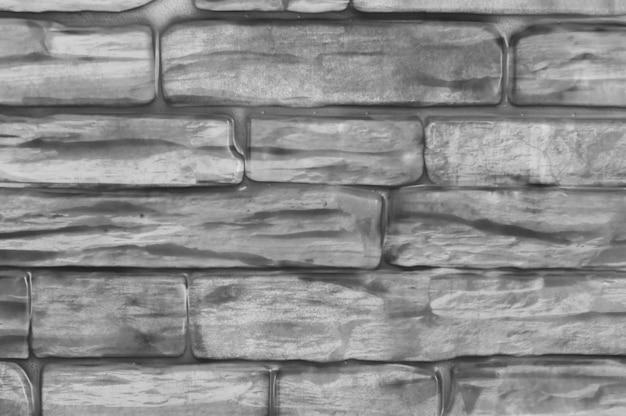背景のレンガの壁の黒と白のクローズアップ。