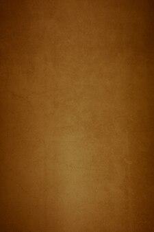 高齢者のテクスチャの古い石膏茶色の背景の壁。