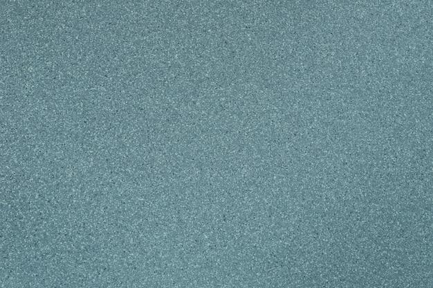 背景に磨かれた御影石のテクスチャライトブルーカラーの使用。