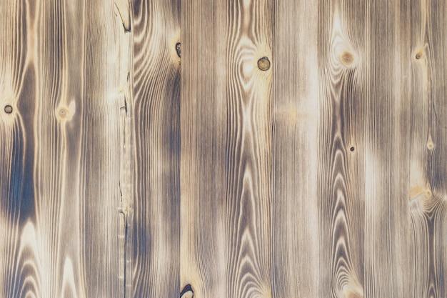 Фон из текстурированных состаренных досок светлого цвета.