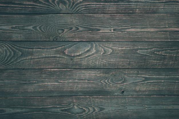 暗いペンキの残骸と木のテクスチャボードの背景。水平です。