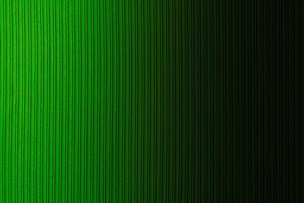装飾的な背景の緑色、縞模様のテクスチャ、水平方向のグラデーション。壁紙。アート。設計。