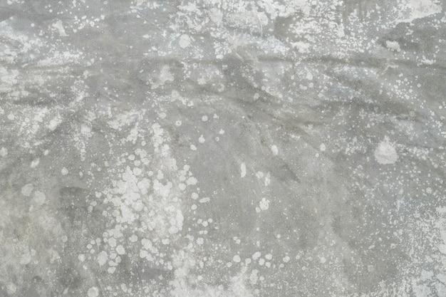 古いコンクリートの壁のテクスチャ。背景の裸のセメントの白い壁のテクスチャ。