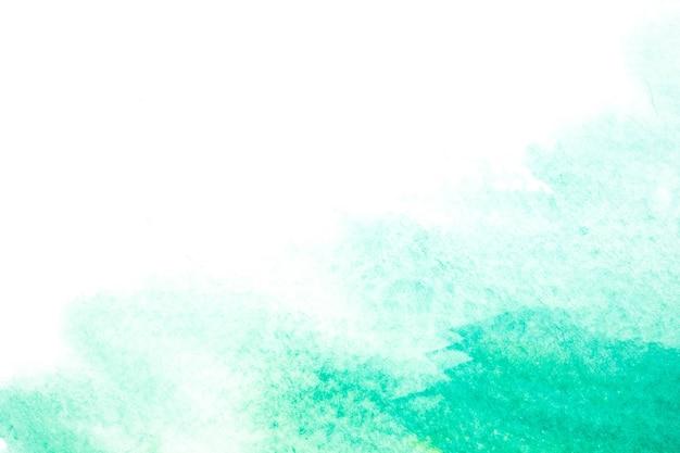 抽象的な美しい光の緑の水彩とテクスチャは、白い背景に