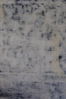 光のまだら模様の斑点を付けられた着色された塗られた老化した木の表面の質感