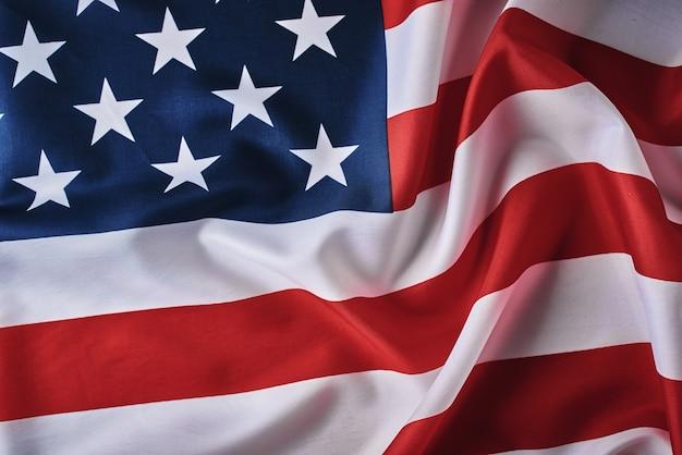 アメリカの国旗の背景。米国旗を振って、クローズアップ
