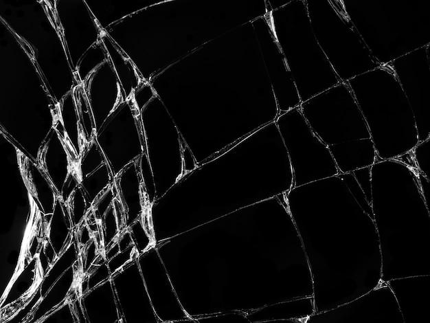 黒い背景にひびの入ったガラスの質感