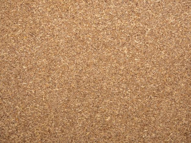 茶色の合板素材テクスチャパターン背景のシートのクローズアップ