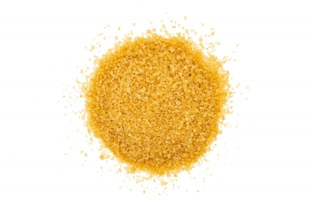 Изолированный пук желтого сахарного песка, конец вверх, макрос, взгляд сверху.