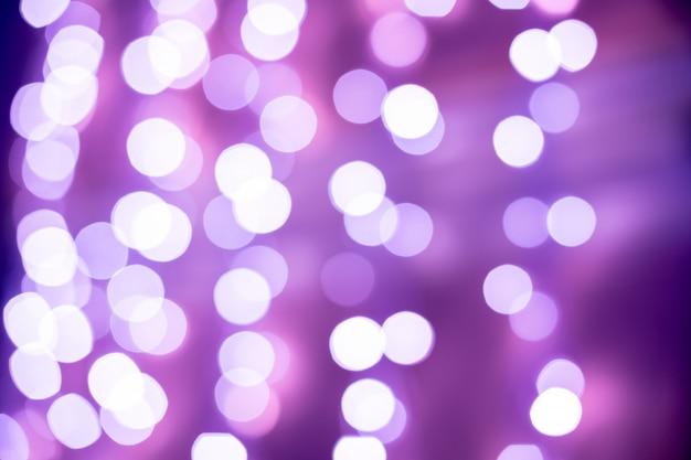 紫のボケぼやけて背景ライト