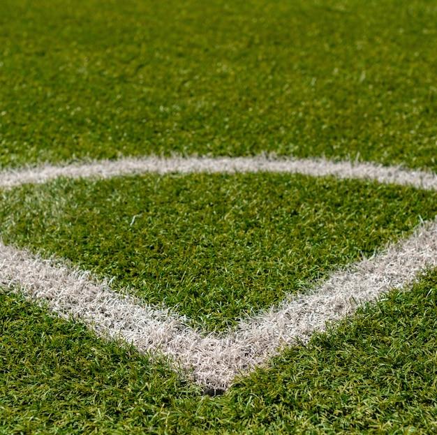 人工芝ハーブのテクスチャはスポーツ分野をカバーします。それは別のサッカーで使われています